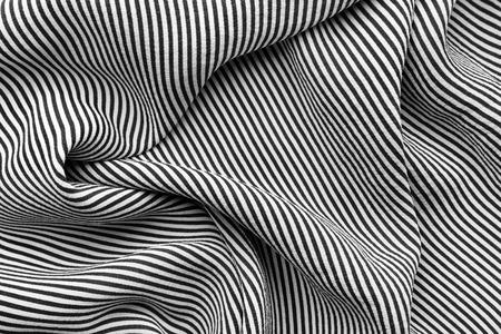 Soie rayée noire et blanche élégante avec des vagues, texture de fond