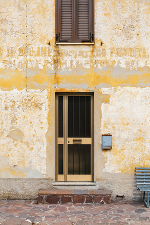 Exterior old building, entrance of house with letterbox and bench Stock Photo - 122876409