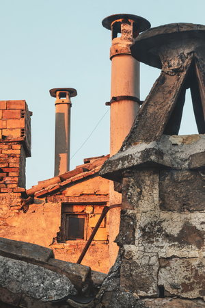 Old brick chimneys of ancient houses,  view from the roofs Stockfoto - 122876551