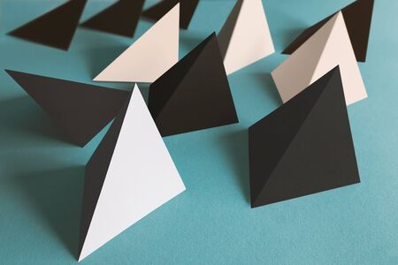 Pyramidal shapes on light blue background, abstract