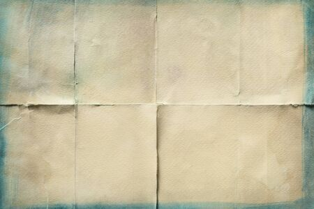 Close-up of old paper folded in eight texture background
