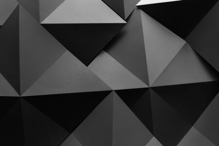 Geometric shapes made of gray paper, abstract background
