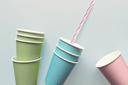 Close-up of paper cups with drinking straw, isolated on light blue background Zdjęcie Seryjne