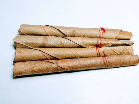 Indian bidi or thin cigar isolated on white background