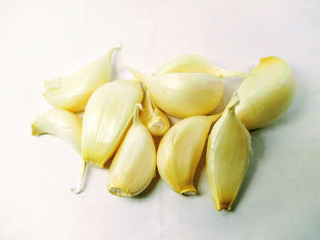 A picture of split garlic isolated on white background