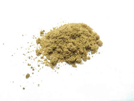 A picture of coriander powder on a white background Stock Photo