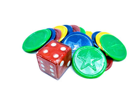 A picture of ludo dice and coins on white background