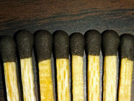 A picture of match sticks isolated on dark background