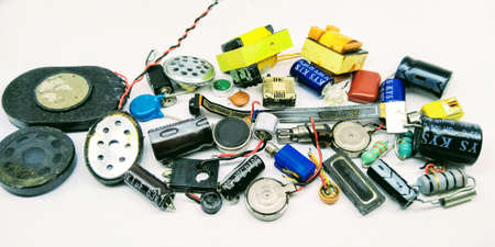A picture of mobile and computer parts on white background