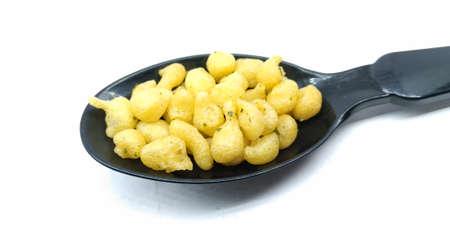 A picture of raita boondi on black spoon Stock Photo - 131571047