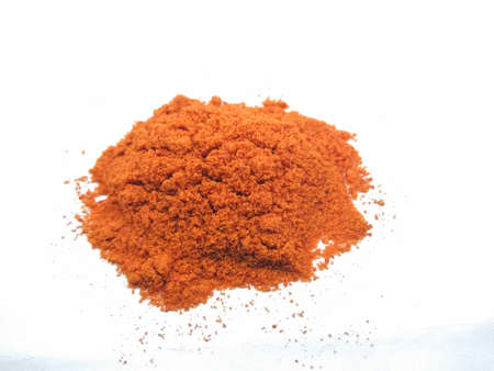 A picture of red chili powder on a white background Zdjęcie Seryjne