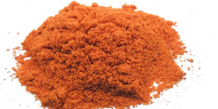 A picture of red chili powder on white background Zdjęcie Seryjne