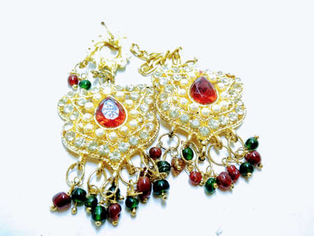 A picture of red diamond earrings on a white background