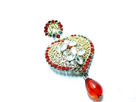 A picture of red diamonds earring isolated on white background