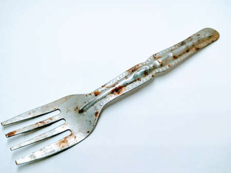 A picture of rusted fork isolated on a white background