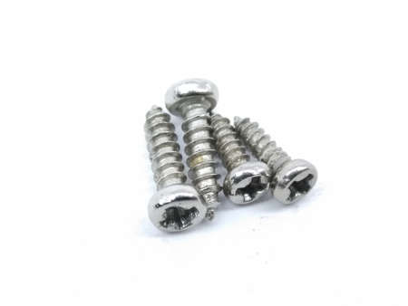 A picture of small screws isolated on white background