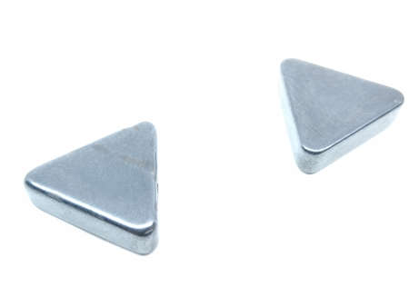A picture of trangle magnets isolated on white background
