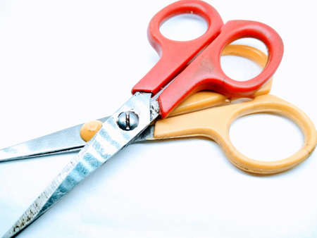 A picture of two scissors isolated on white background Фото со стока