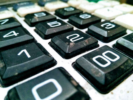 A picture of used calculater keypad with blur background