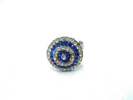 A picture of white and blue diamonds ring on white background