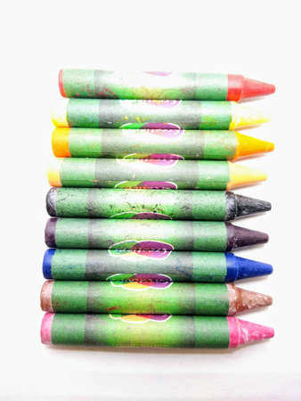 A portrait picture of wax crayons color on white background