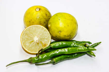 A picture of green chilies with fresh lemon