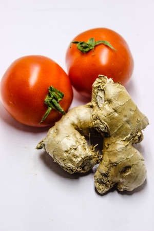 A picture of fresh tomatos with ginger