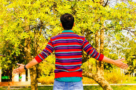 A picture of young boy facing away from the camera Stock Photo