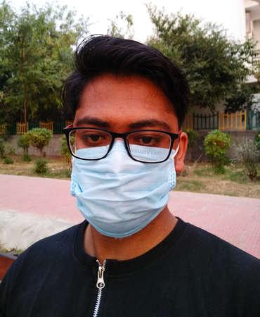 Beautiful young boy model wear a mask to avoid corona virus