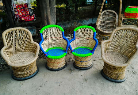 A picture of wood chairs with selective focus