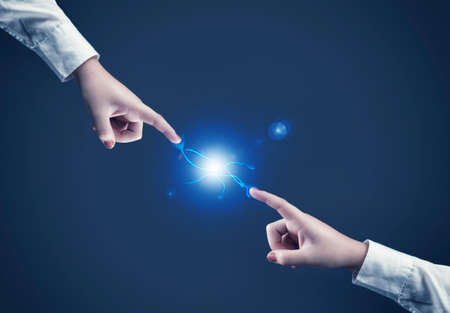 magick: Two hands reaching towards each and make a connection