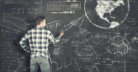 Teenager solving some math  problems on blackboard Stockfoto