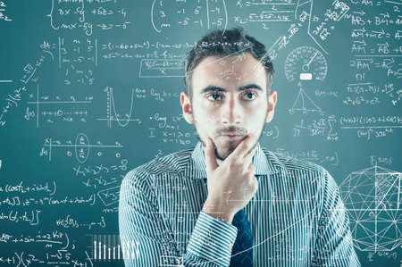human intelligence: The young businessman tries to solve problems