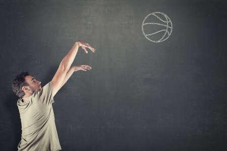basketball shot: Basketball player shooting a drawn ball on the chalkboard