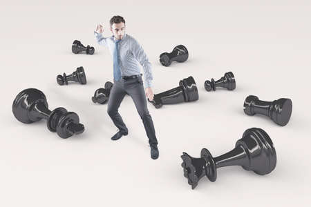 breaks: Young businessman breaks chess pieces Stock Photo