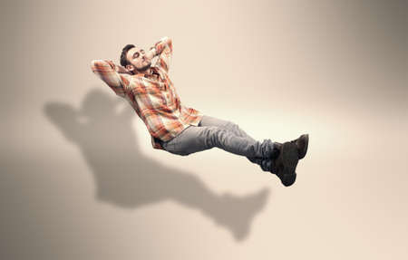 invisible: Young man relaxes on a invisible sofa