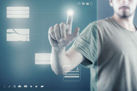 press: Young man pressing on a touch screen, modern technology icons