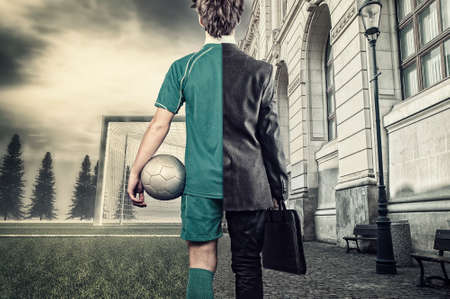 Young man half soccer player half bussiness man. In a city and  soccer field. Stockfoto