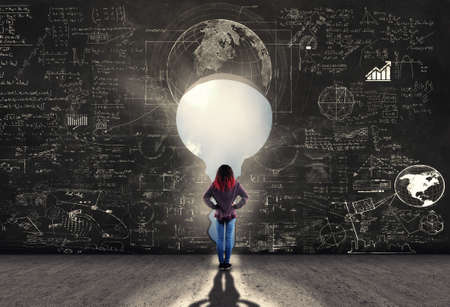 Confused young girl look through the keyhole and math formulas on blackboard
