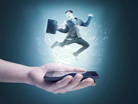 Holding a phone with hologram of a businessman jumping
