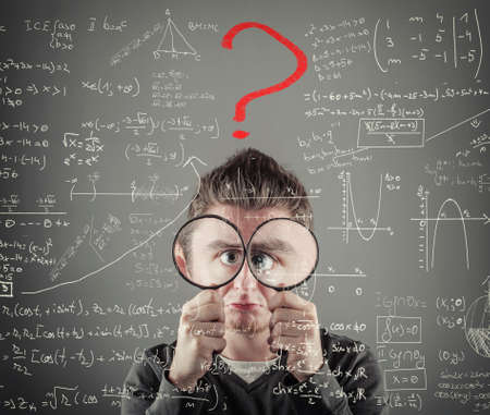 inocent: Helpless man is looking through two magnifying glasses to mathematical formulas and problems. Red question mark .