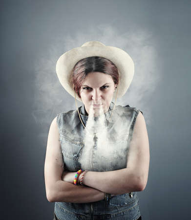 aggravated: Angry women briging smoke out of her nose .