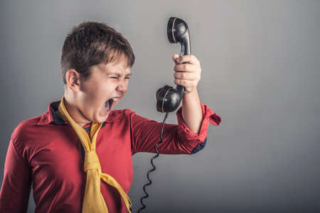 angry kid: Angry kid screaming at vintage receiver