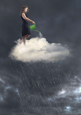 damping: Woman in black dress standing over a cloud creating rain with watering can