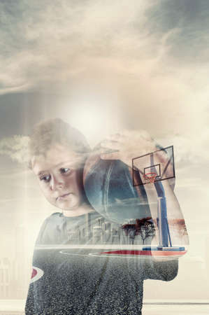 composit: Double exposure of a thoughtful kid holding a ball on a basketball court enviroment.