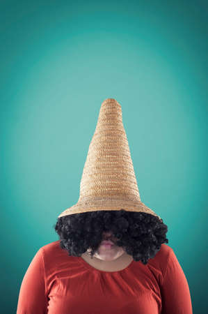 pulled over: Young girl with a big straw hat pulled over his eyes Stock Photo