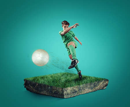 attribution: Teen playing soccer on a cube of grass.
