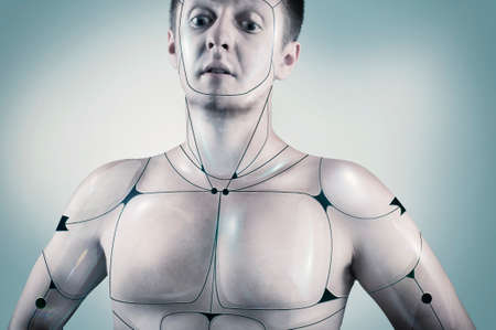 attribution: Portrait of a cyborg male in a blue background.