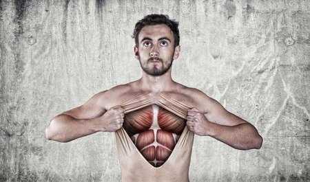 Man ripping off his chest skin to show off muscle anatomy. Stock Photo
