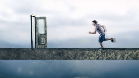 hurried: Young man running to an opened door. Stock Photo